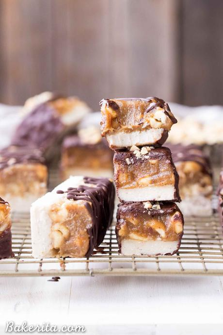 These Homemade Snickers Bars are a healthier version of the classic candy with no baking required! These gluten-free and vegan candy bars have a layer of raw nougat, topped with a peanut date caramel, all dunked in homemade chocolate.