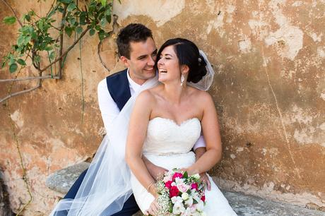 Villa Catignano Siena Wedding Photography bride and groom in front of plaster wall