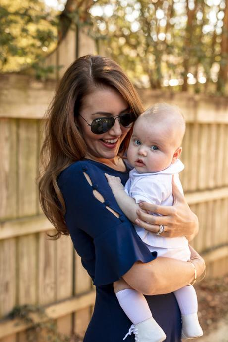 Amy Havins wears a navy shoshanna dress with baby ralph.