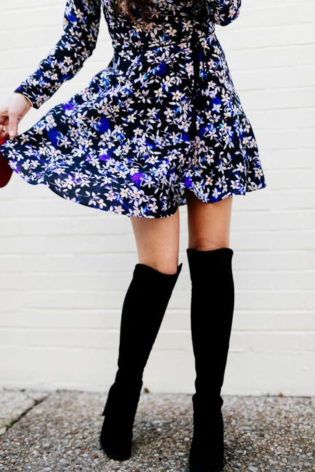 Amy Havins wears a blue floral print Shoshanna dress with Stuart Weitzman over the knee boots.