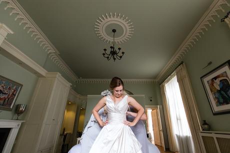 York Wedding Photographers bride getting into dress
