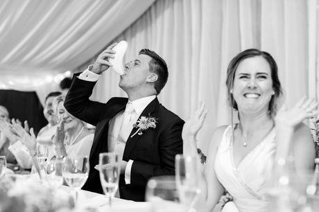 York Wedding photographers groom taking shot from cricket box