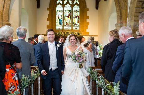 York Wedding photographers walking up aisle