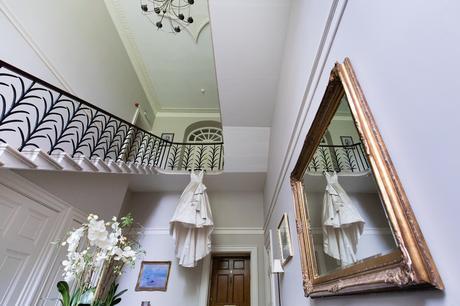 York Wedding Photographers Ian Stuart Dress hanging from stairs