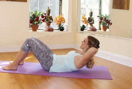 woman exercising pilates at home