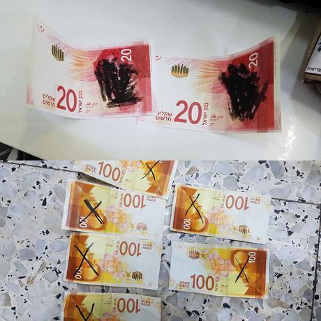 Defacing new bills in Mea Shearim