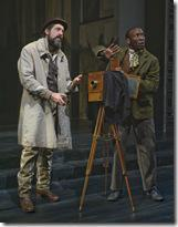 (left to right) Arly Wilcox (ensemble member Ian Barford) begrudgingly assists Calvin Harper (Phillip James Brannon) in taking a photograph in Steppenwolf Theatre Company's world-premiere production of The March, based on the novel by E.L. Doctorow, adapted and directed by ensemble member Frank Galati. The March runs April 5 – June 10, 2012 in Steppenwolf's Downstairs Theatre (1650 N Halsted St).