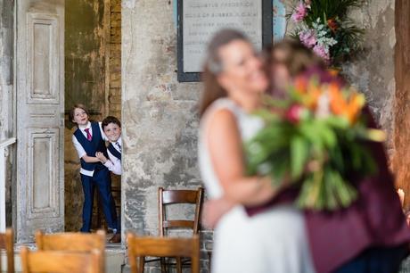 Little kids watch parents cuddle at London wedding at Asylum in London