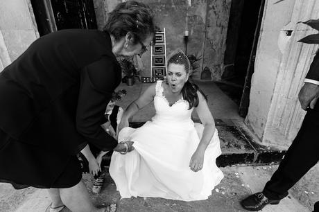 Bride sits down on step at Asylum in London