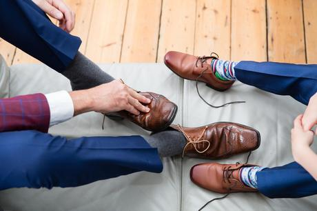 Groom and son get their leather shoes on Quirky wedding photography