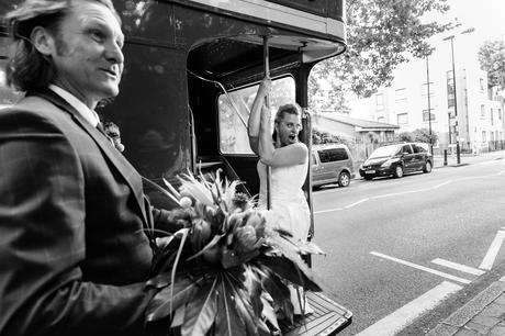 Bride pole dances on red London bus at quirky & fun wedding in London