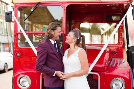 Bride and groom portrait in front of London bus