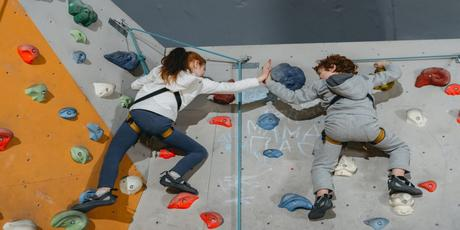 kids high five on a wall