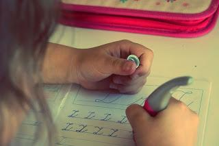 Image: Child learning to print, by StockSnap on Pixabay