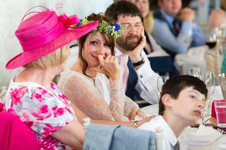 Bride smiles and cries during speeches