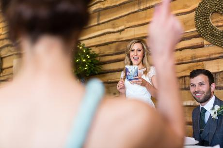 Bride points at cheering mom during speeches Best York Documentary Photography