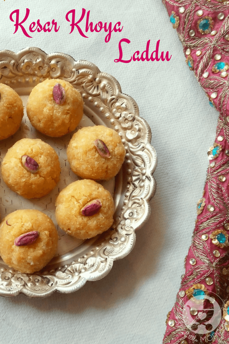 Traditional khoya, nutty coconut and beautiful saffron come together in this delightful festive dessert - Khoya Kesar Laddu Recipe for kids!