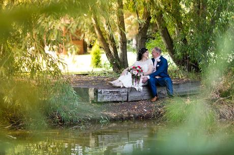 Villa Farm Weddings bride and groom on the jetty