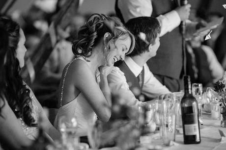 Villa Farm Weddings bride laughing during speeches