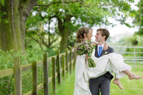 Villa Farm Weddings groom carries the bride