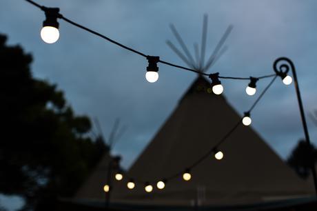 Tipi and festoons in twilight Villa Farm Weddings