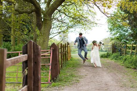 Villa Farm Weddings groom kicking up heels