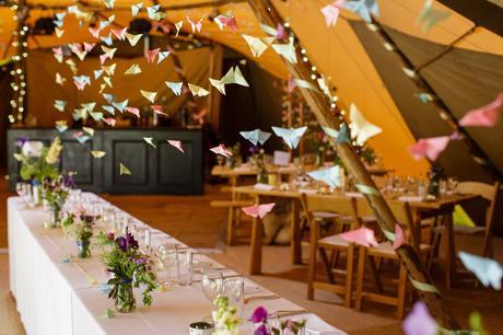 Villa Farm Weddings tipi interior with paper cranes