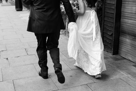 Bride's dad hold's bride's dress