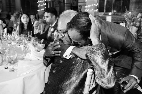 Groom hugs dad after speeches St Stephens Hampstead Wedding Photography