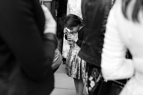 Wedding photograph of little girl sipping champagne from glass