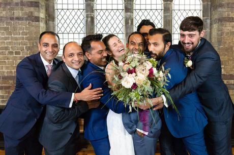 St. Stephens Hampstead Wedding big group shot with massive smiling hug