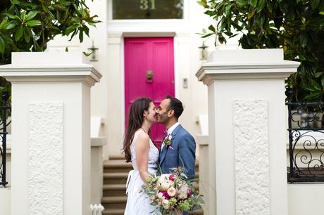 St. Stephens Hampstead Wedding kissing in front of a pink door