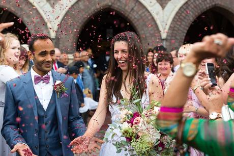 St. Stephens Hampstead Wedding Lots of confetti and bride laughing
