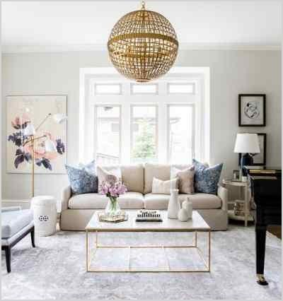 looking for living room ideas be inspired by this neutral living room with rose gold and pink accents