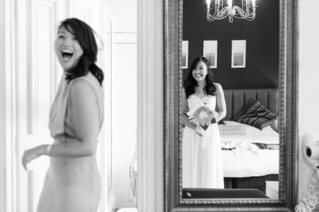 Preston Court Wedding Photography documentary shot of bride and sister laughing in mirror