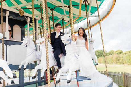 Preston Court Wedding Photography bride and groom on the carousel