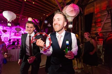 Guest palying the tambourine during the disco Preston Court Wedding Photography