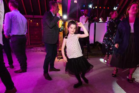 Little girl dances at wedding