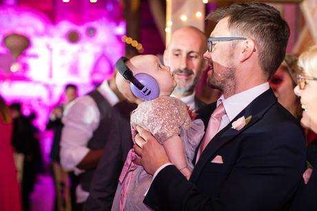 Preston Court Wedding Photography baby with ear protection during the party