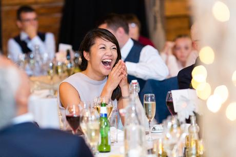 Guest smiling and laughing during the speeches Preston Court Wedding Photography