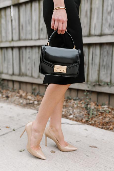 Amy Havins wears a jill jill stuart little black dress.