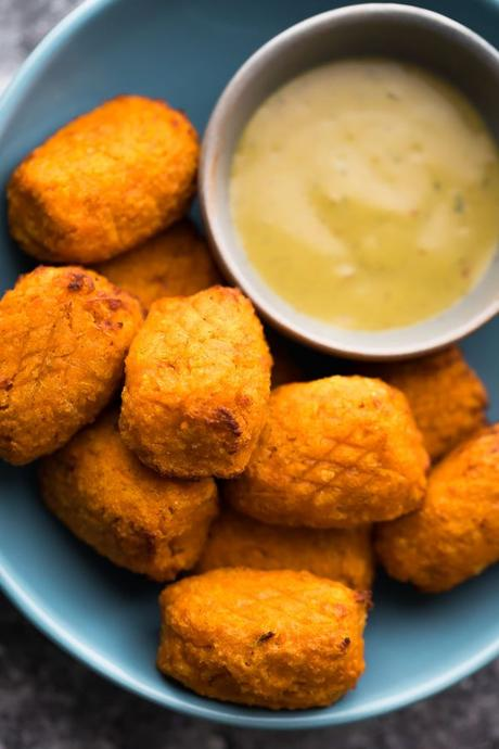 Crispy air fryer sweet potato tots are made with only five ingredients and just a touch of spray oil. They can be made ahead and frozen, then go directly into the air fryer from frozen for an easy, kid-approved snack or side dish. Recipe includes directions for making these sweet potato tots in the oven as well.