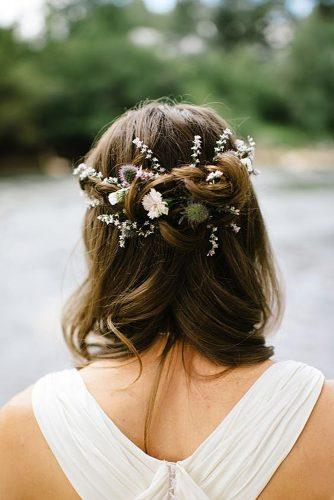 rustic wedding hairstyles bridal swept half up half down with wild plants flowers yellow feather photography