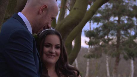 the bride and groom chat near the line of trees at Nunsmere hall