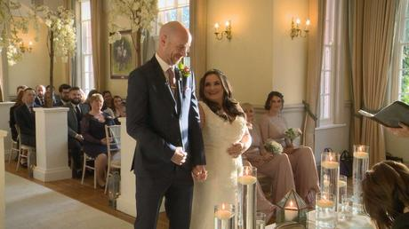 the bride and groom laugh and look relaxed on their wedding video during the ceremony in Cheshire