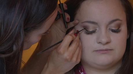 The make up artist applies the perfect feline flick for the bridal make up at a wedding in Nunsmere Hall in Northwich