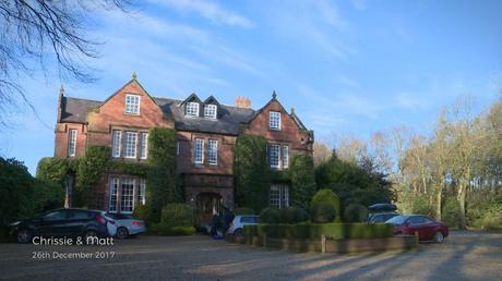 The front of Nunsmere Hall in the low winter light before a wedding