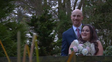 the bride and groom look relaxed as they laugh and pose in the gardens at Nunsmere hall