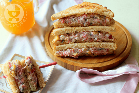 Sandwiches are among the easiest ways to tackle your little one's hunger pangs! Try out this hung curd vegetable sandwich that is packed with flavor, nutrition and a good crunch!