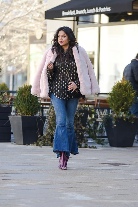 how to wear daytime sparkle, fashion, flared hem jeans, pink fur coat, street styled, casual, dressy, black ruffle hem shirt, pink stripe booties, myriad musings